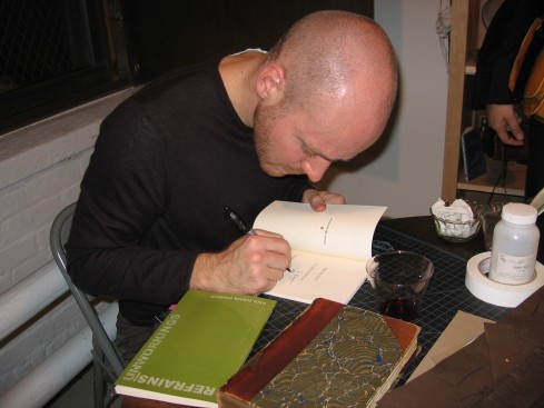 The Poet Signing Books